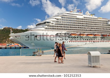 PHILIPSBURG, ST. MAARTEN - Jan 19:  Cruise passengers proceed to board cruise ship after spending a day in the port of St. Maarten, a popular destination in the Eastern Caribbean, on Jan. 19, 2011. - stock photo