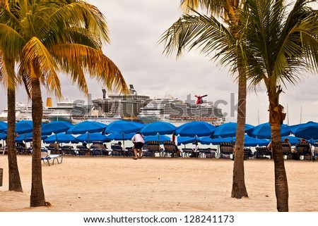 PHILIPSBURG, ST. MAARTEN - JAN. 16:  Cruise ships anchored in the port of St. Maarten on Jan. 16, 2013.  Philipsburg has become a larger port over recent years, able to accommodate six ships a day. - stock photo