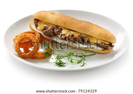 philly cheese steak sandwich with onion rings - stock photo
