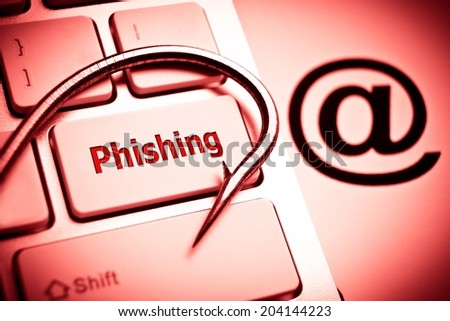 phishing / a fish hook on computer keyboard with email sign / computer crime / data theft / cyber crime - stock photo