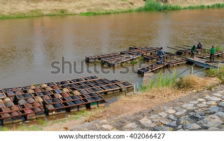 PHITSANULOK,THAILAND - APRIL 6, 2016 the raft  made of iron tank in river Wat Phra Sri Rattana Mahathat  April 6, 2016 in phitsnulok,Thailand. - stock photo