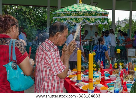 PHITSANULOK,THAILAND - JANUARY 16, 2016: Buddhists on altar to pay their respect to Lord Buddha in Buddhist temple, Thailand - stock photo