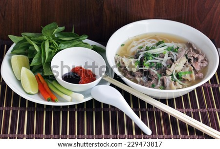 Pho Beef noodle soup eating with basil - stock photo