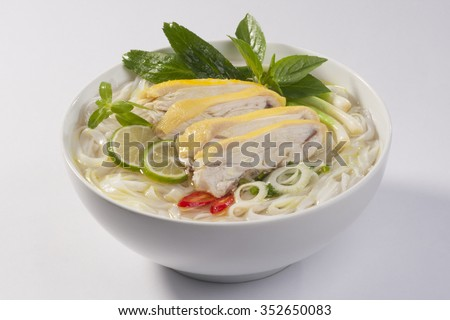pho ga, vietnamese chicken rice noodle soup with chicken, herbs and chili. - stock photo