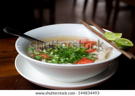 Pho soup as it is served in south east asia. With fresh spices and herbs. - stock photo