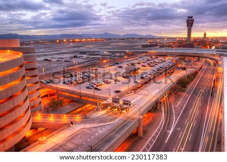 Phoenix airport at dawn with light trails in the street. - stock photo