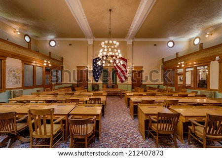 PHOENIX, ARIZONA - AUGUST 6: Interior of the original House of Representatives in the Arizona State Capitol building on August 6, 2014 in Phoenix, Arizona - stock photo