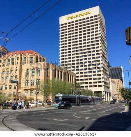 PHOENIX, AZ - FEBRUARY 8, 2016: Wells Fargo Bank skyscraper rising above historic buildings at 1st Avenue and Jefferson Street in Phoenix, Arizona - stock photo
