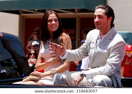 PHOENIX, AZ-JULY 12: Milwaukee Brewers outfielder Ryan Braun rides with girlfriend Larisa Fraser at the 2011 MLB Chevy All-Star Red Carpet Parade on July 12, 2011 in Phoenix, Arizona. - stock photo
