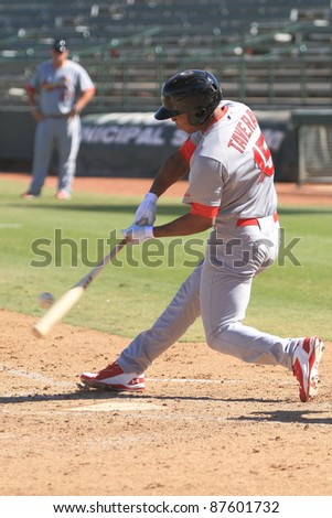 PHOENIX, AZ - OCTOBER 19: St. Louis Cardinals prospect Oscar Taveras bats for the Peoria Javelinas in the Arizona Fall League Oct. 19, 2011 at Phoenix Municipal Stadium in Phoenix, AZ. Taveras went 3-for-4. - stock photo