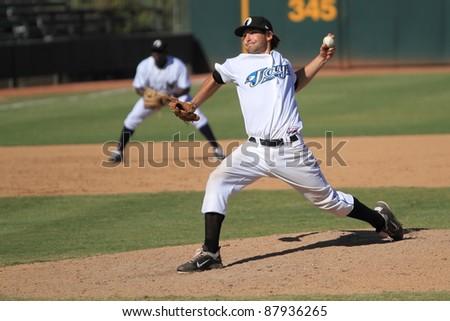 PHOENIX, AZ - OCTOBER 19: Toronto Blue Jays Double-A prospect Evan Crawford pitches for the Phoenix Desert Dogs in an Arizona Fall League game Oct. 19, 2011 at Phoenix Municipal Stadium, Phoenix, AZ. - stock photo