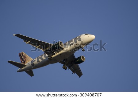 Phoenix July 7th 2015, Frontier Airlines,  AIRBUS A319-111 Landing at Phoenix Sky Harbor Airport.  Frontier Airlines is a United States low-cost carrier airline headquartered in Denver, Colorado, USA. - stock photo