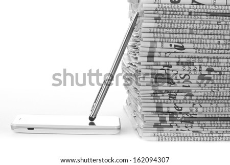 Phone and Newspapers folded and stacked concept for global communications  - stock photo