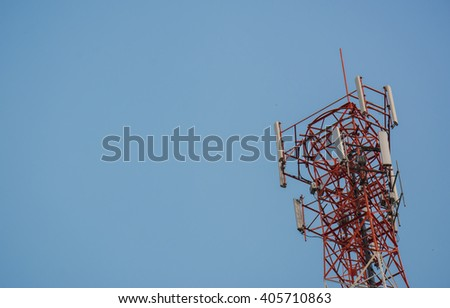 Phone antenna on a blue sky. - stock photo