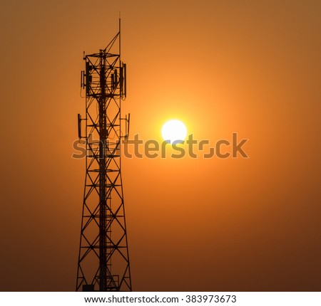 Phone Antenna Tower with a sunset in the background. Thailand  -  Silhouette-Evening light -  Right area -suitable for copy space. - stock photo
