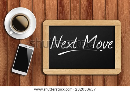 Phone, Coffee And A Chalkboard On The Wooden Table Written Next Move - stock photo