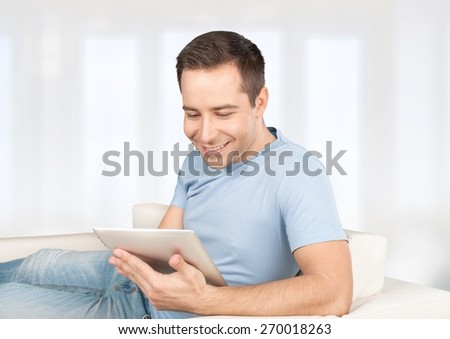 Phone. Handsome man using smartphone at home - stock photo