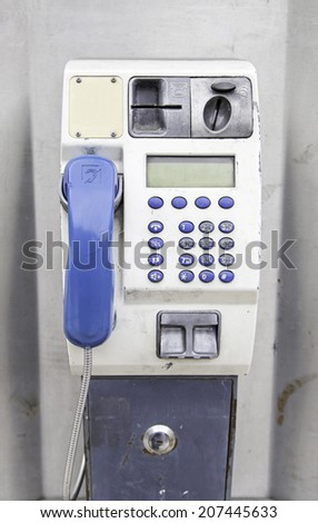 Phone in the city, detail of an urban telephone, communication in the city - stock photo