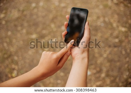 phone in the hands of women - stock photo