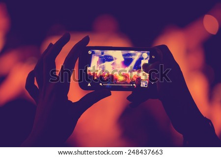 phone in the hands of women on the show - stock photo