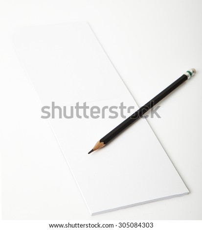 phone Note book paper with pencil  - stock photo
