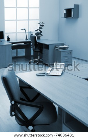 phone on a desk in a modern office - stock photo