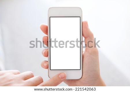 phone with isolated screen in female hands - stock photo