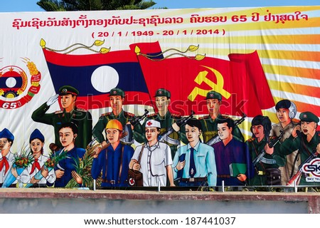 PHONGSALI, LAOS -  FEBRUARY 3: Big propaganda poster in the town center ,  on February 3, 2014, in Phongsali, Laos . - stock photo