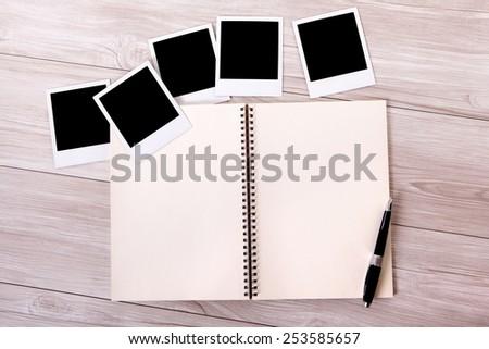 Photo album, blank polaroid instant photo prints.  - stock photo