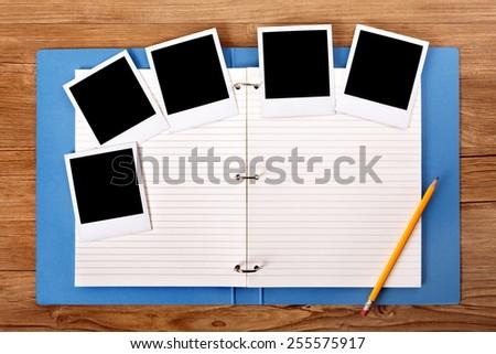 Photo album, blank polaroid photo prints.    - stock photo