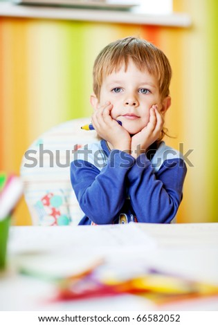 Photo baby boy with the album and pencils - stock photo