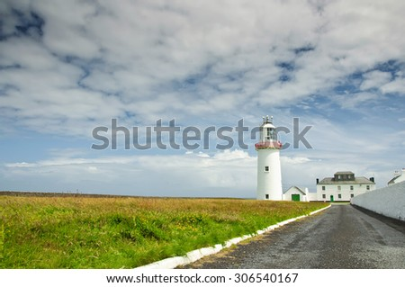 photo beautiful lighthouse from the west coast ireland - stock photo