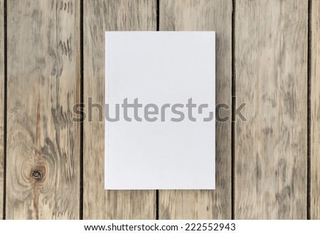 Photo blank brochure cover on a wooden vintage texture - stock photo