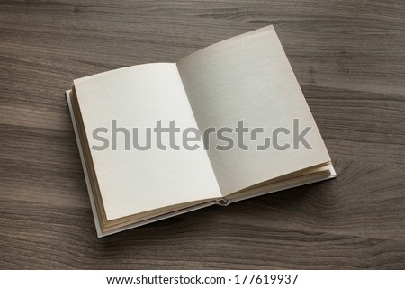 Photo blank open book on textured wood background - stock photo