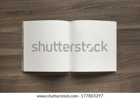Photo blank. Open square format brochure on a wooden table - stock photo