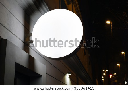 Photo blank signboard on the street at night - stock photo