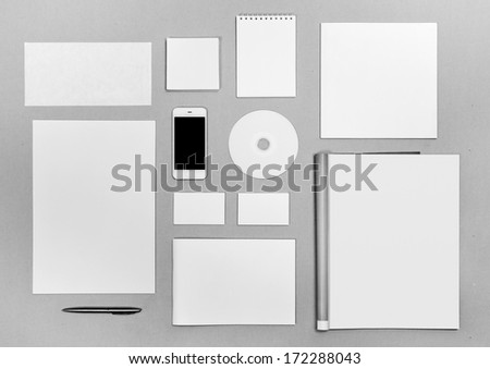 Photo. Blank stationery set on on the texture background / business cards, letterheads, disk, envelope, booklet, notepad, magazine, phone, brochure - stock photo