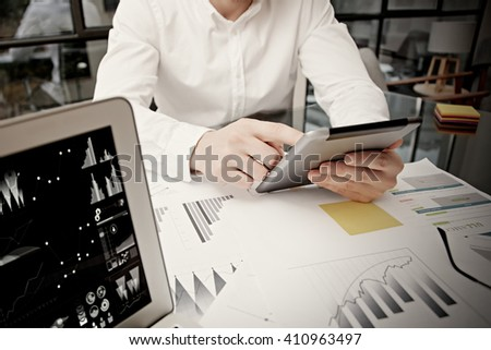 Photo businessman touching modern tablet screen.Trader manager working new private banking project office.Using electronic devices.Graphics icons,worldwide stock exchanges notebook. Bokeh,film effect - stock photo