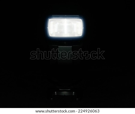 Photo camera flash isolated on black background - stock photo