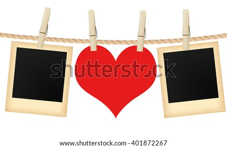 photo cards and heart hanging on rope isolated on white background - stock photo