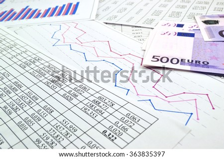 Photo charts and graphs with money - stock photo