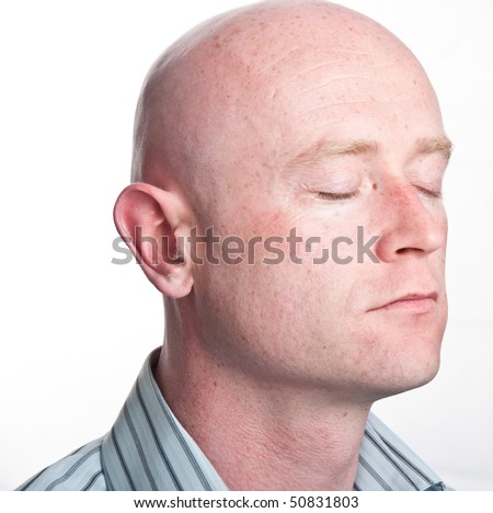photo close up male shaved bald head - stock photo