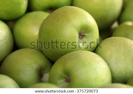 Photo closeup many clean organic fresh tasty ripe green apples crop fruit full of vitamin for healthy eating diet ball form for sale on natural background, horizontal picture - stock photo