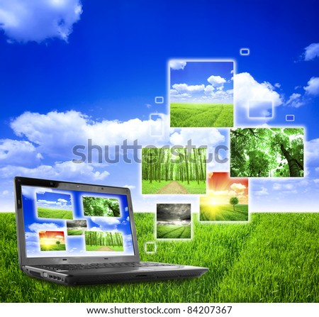 Photo collage of notebook on nature background - stock photo