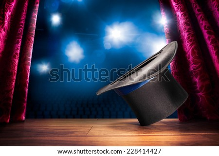 photo composite of a magic hat on a stage - stock photo