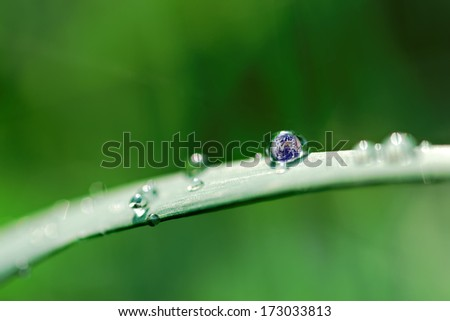 photo composition,the planet earth inside a water drop - stock photo