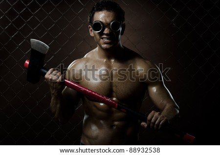 photo crazy frenzied chopper  butcher man ,  action with big axe - stock photo