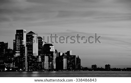 photo downtown new york city skyline at sunset evening - stock photo