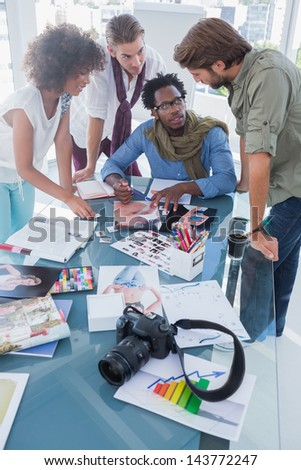 Photo editors having brainstorming in their office - stock photo