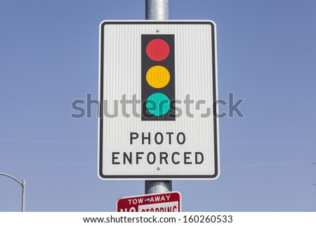 Photo enforced traffic light warning sign. - stock photo